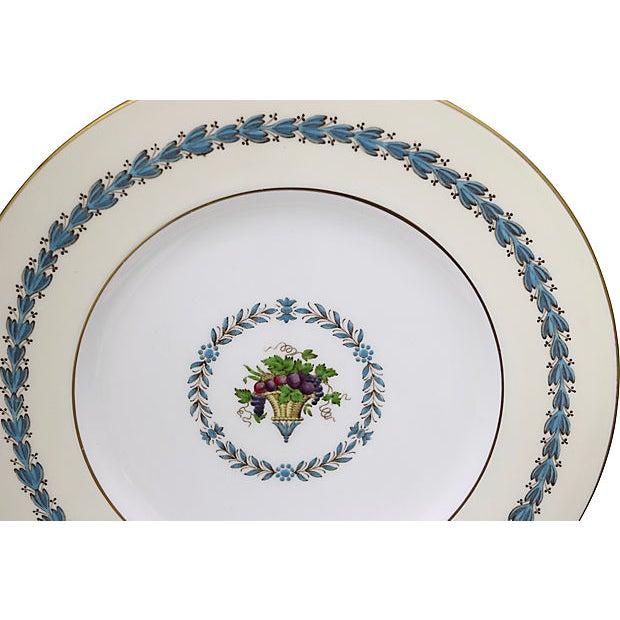 Set of eight floral Wedgwood large dinner plates. Maker's mark on underside.