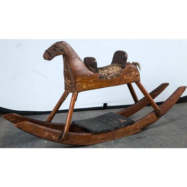 Child's rocking horse, circa 1900. Carved wood, original finish. A wonderful piece of American Folk Art. Provenance: du...