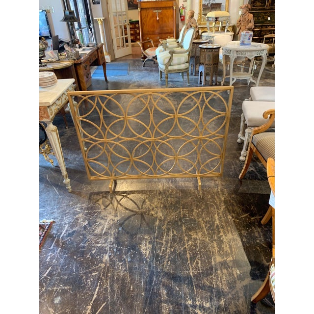 Beautiful modern style steel fire place screen custom made by Legacy. Circular pattern in gold gilt. Very special! It will...