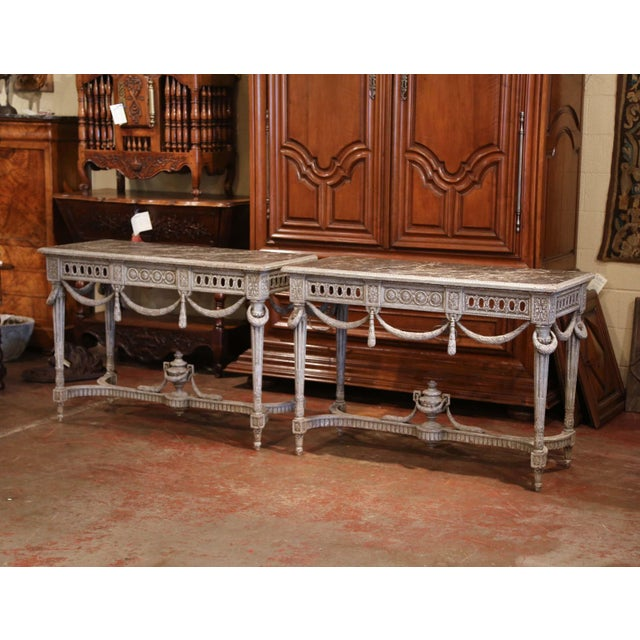 These elegant antique Louis XVI consoles were created in France, circa 1870; each sofa table features beautiful wood...