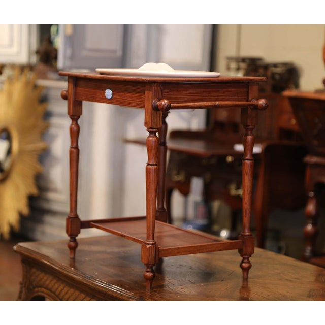 Decorate a little girl's room with this antique washstand and lavabo. Crafted in France circa 1880, the pine table has...