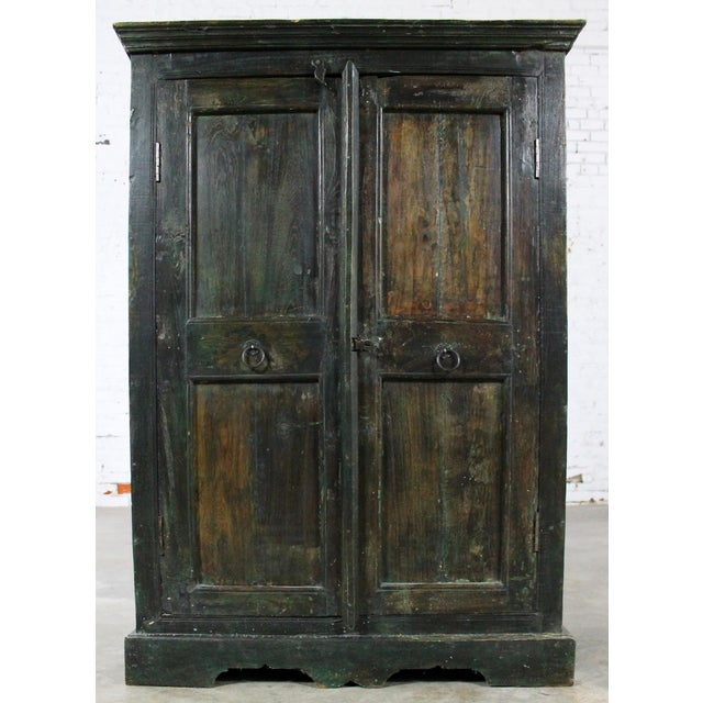 Gorgeous primitive cupboard or storage cabinet with a rustic finish and distressed paint. We believe this piece to be 20th...