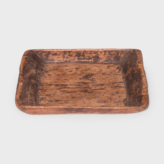 Carved from a large timber of elmwood, this primitive tray charms with its humble rustic finish and simple form. Marked...