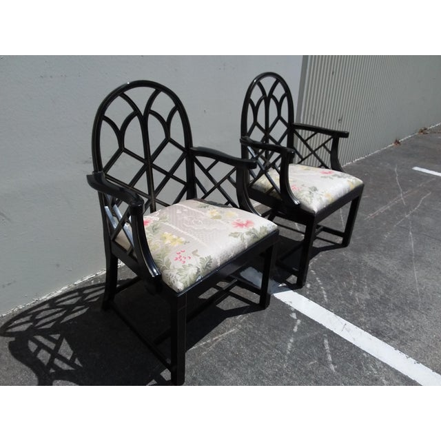 Great looking pair of late 20th century arm chairs with lattice back and painted black finish and gold decoration.