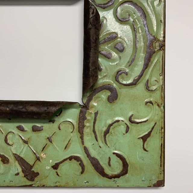 Beautiful celery green and rust brown decorative ceiling vintage tin frame.