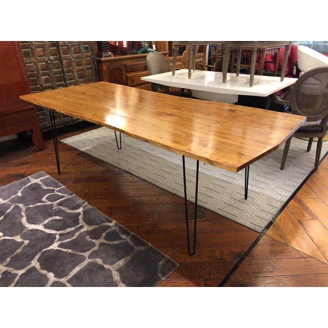 Design Plus Gallery presents a custom live edge wood table by Monument, San Francisco. A modern take of earth elements and...