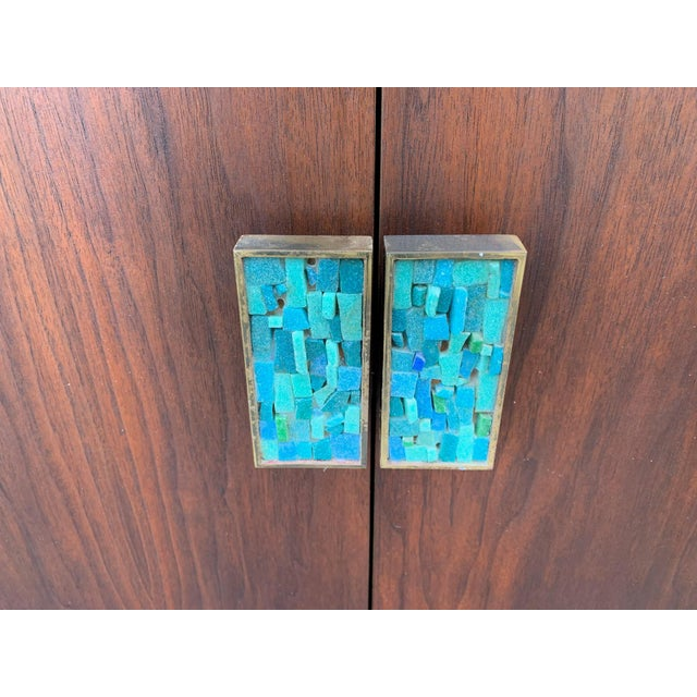 This Mid-Century Modern Mahogany Chest by Monteverdi Young is a Unique piece featuring turquoise resin and stone handles...