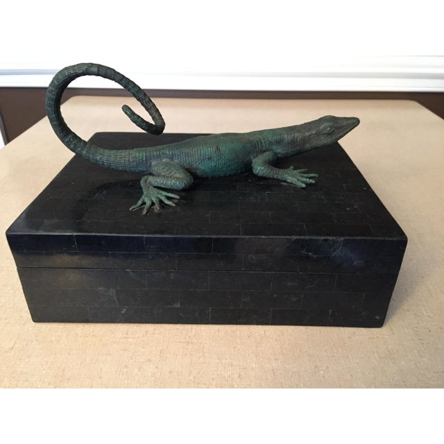 Patinated bronze lizard atop very dark green and black box covered in tessellated pattern over wood interior. Intricate...