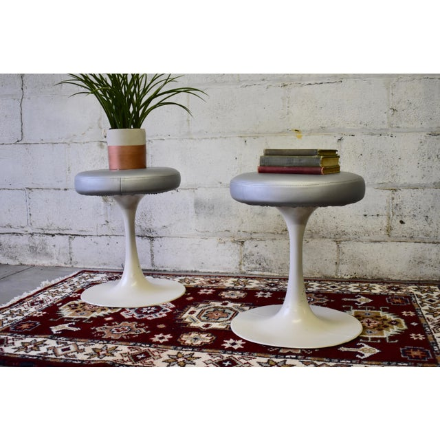Vintage Knoll style cast aluminum Tulip stools with silver naugahyde (vinyl) tops. Stamped Cre-Rossi (France) underneath...