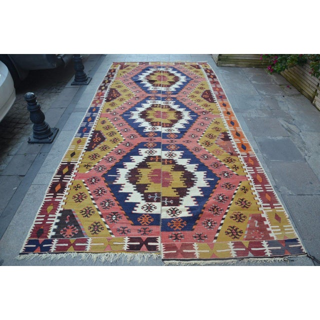 Turkish vintage handwoven kilim rug from Anatolian wool on woo. Good condition for use.