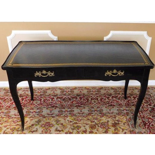 This is an excellent vintage 1940-1950 black lacquered French Louis XV style bureau plat ~ writing desk by Jacques Bodart....