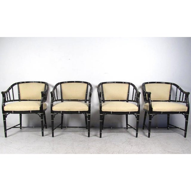 This set of four barrel back dining chairs features unique lacquered bamboo style frames complete with comfortable...