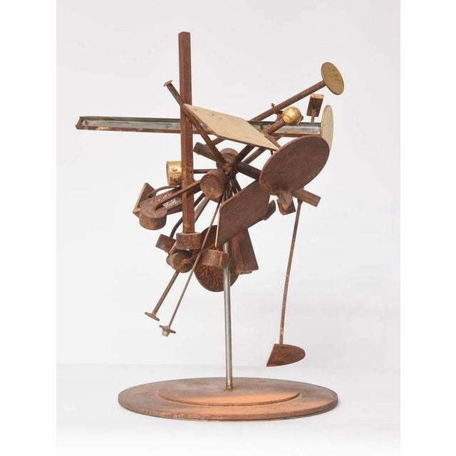 Perfectly and auspiciously whimsical. Iron and gold leaf kinetic sculpture, in abstract form - a tabletop sculpture. The...