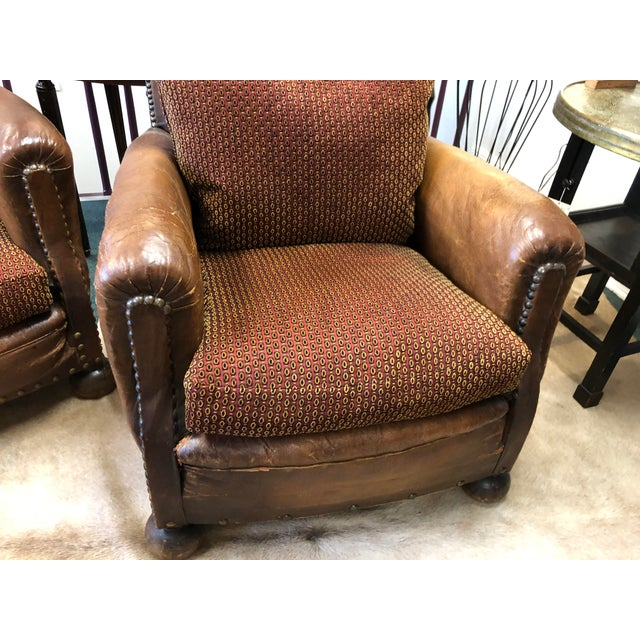 Handsome pair of leather club chairs from France made from leather and wood , normal scratches and abrasions in leather...