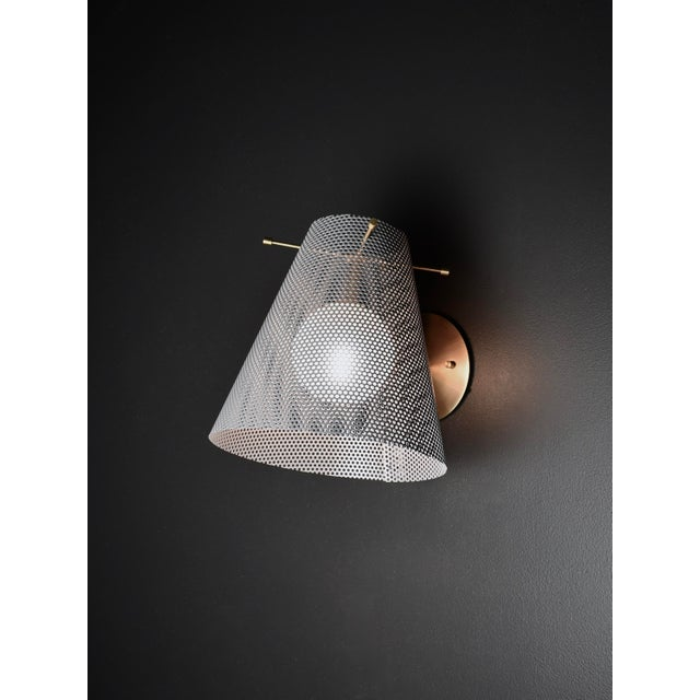 The Crinoline wall sconce is a handsome sculptural design that works well in both modern and transitional interiors. Shown...