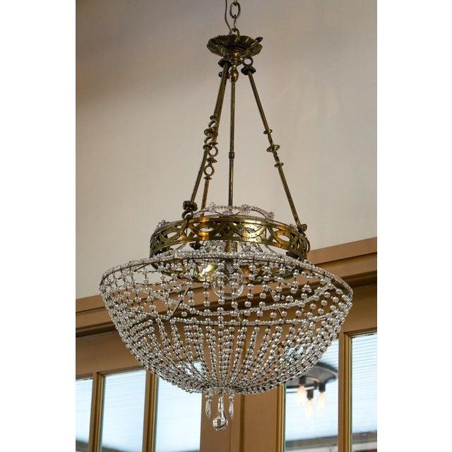 Vintage glass beaded basket chandelier from Austria. Glass beaded basket-form chandelier, with a gilt-brass frame,...