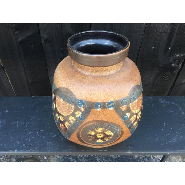 Bulbuos Lapid of Israel stoneware vase with a geometric designs in vivid golds, blues and browns. Signed to the underside.
