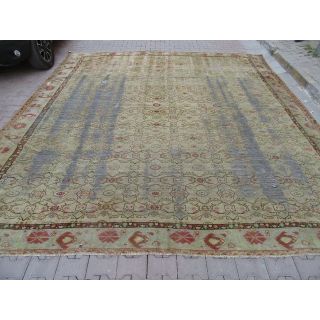 Antique Distressed Oushak rug. Approximately 75-85 years old. In very good condition