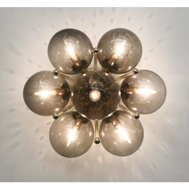 Italian modern flush mount or wall light with 7 smoky Murano glass globes carefully hand blown with bubbles inside the...