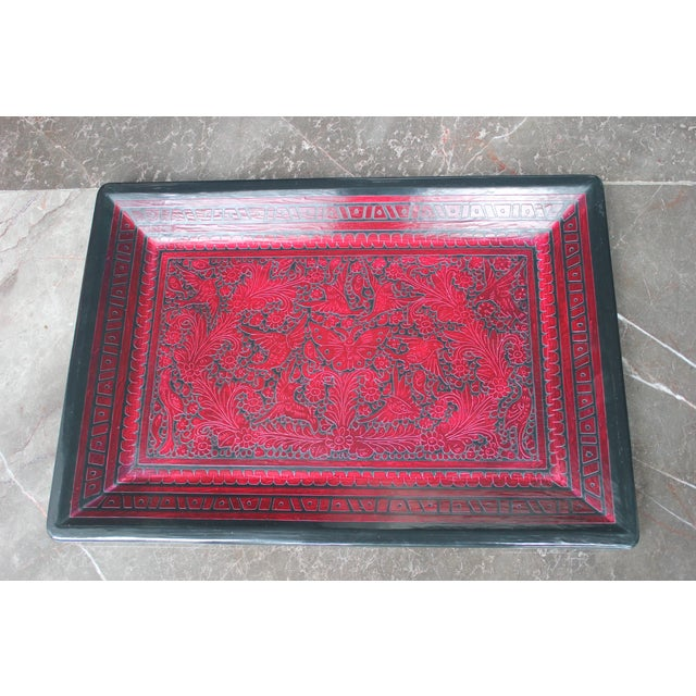 Here is a lovely hand-carved wooden tray. This features rich red and black coloring. Lacquerware refers to decorated...