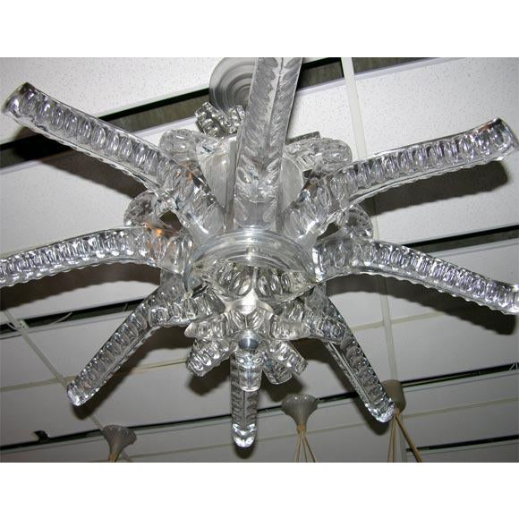 """""""Monaco"""" chandelier designed by Marc Lalique in the 1950s, featuring an octopus-like shape created by multiple crystal..."""