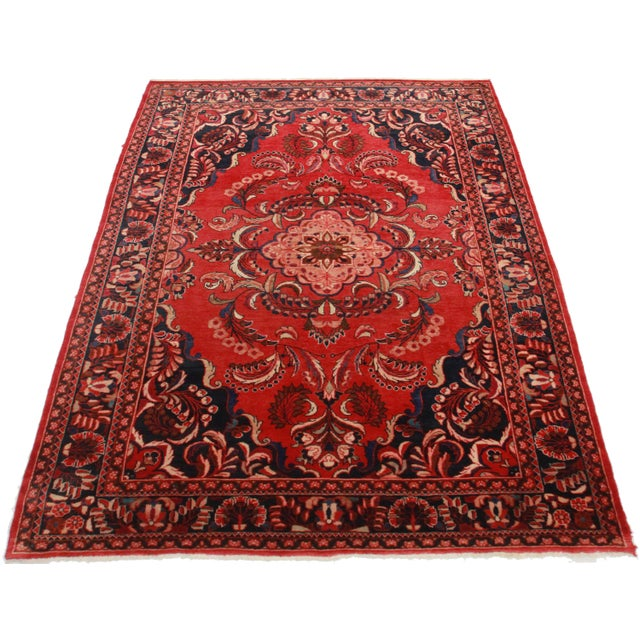 Crafted of hand-knotted wool, this Persian Mahal features a geometric design.