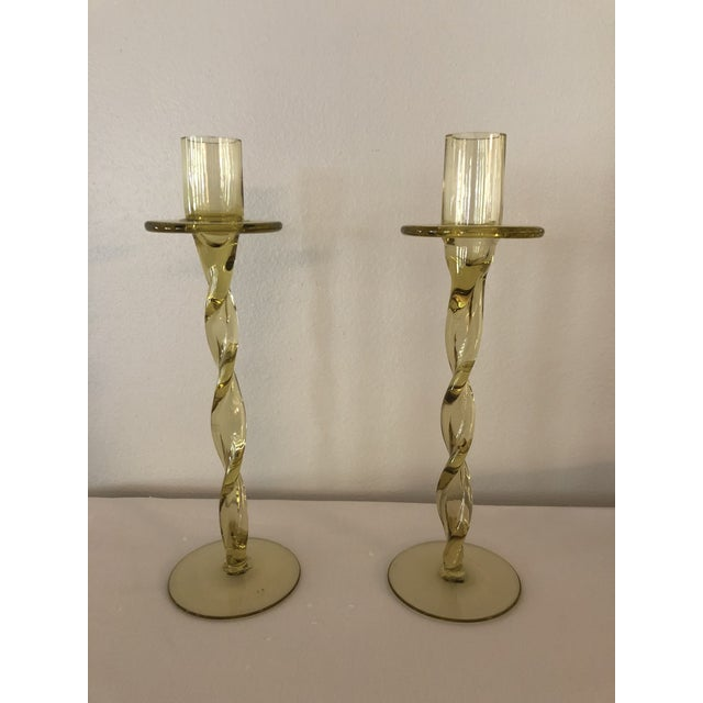These are beautiful hand blown glass - very delicate and not at all clunky. The color is pale amber. These candlesticks...