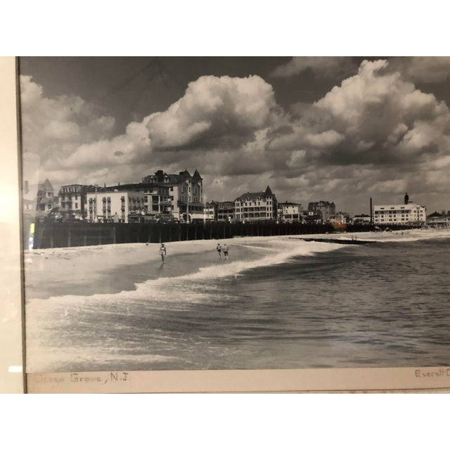 A vintage black and white photograph of a seaside scene in Ocean Grove, New Jersey, 1940's, by photographer Everett Clark....