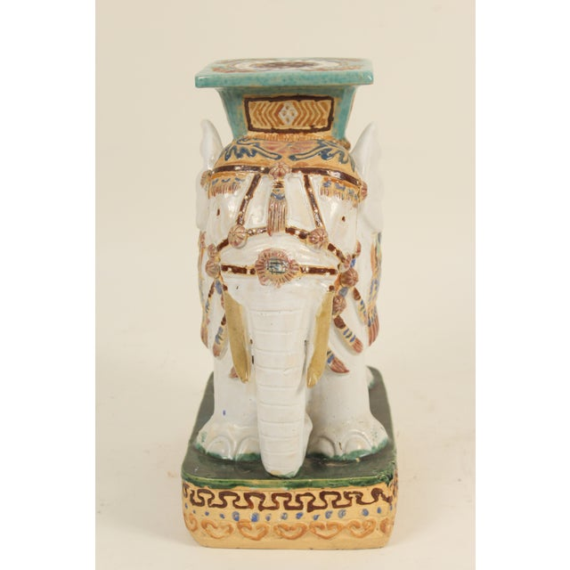 Pair of Chinese polychrome decorated stoneware elephant form garden seats. Made in the 1980s.