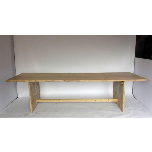 Stunning modern elm board table with perpendicular bases and stretcher. Beautiful, weathered patina, soft to the touch. It...