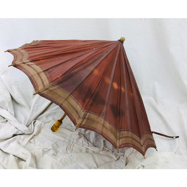 "Fabulous Antique ""Hercules"" Metal Spoke Umbrella with Amber Floral Fittings. Wonderful for merchandising or if used as a..."