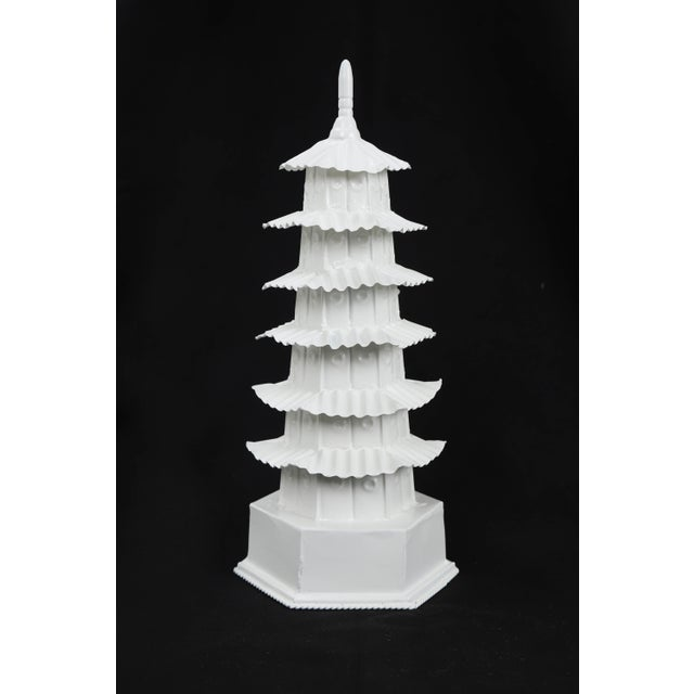 """This white painted tole pagoda has 6 levels with a finish. Each """"panel"""" is seemingly decorated with a cosmetic dent,..."""