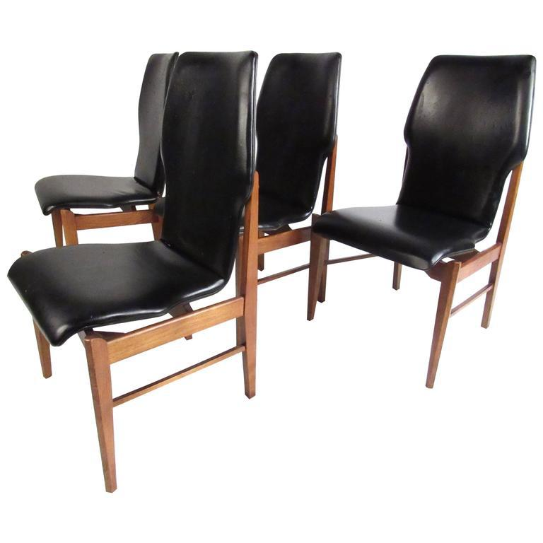 This Stylish Set Of Four Matching Dining Chairs Offer A Shapely Vinyl  Covered Seat, With