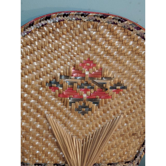 Set of two hand woven, I believe from Thailand,Decorative hand fans. One does have damage. Please see photos for full...