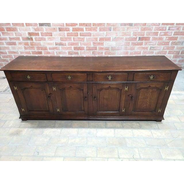 Timeless antique French country oak sideboard buffet server or credenza. Beautiful original hand-wrought iron handles and...