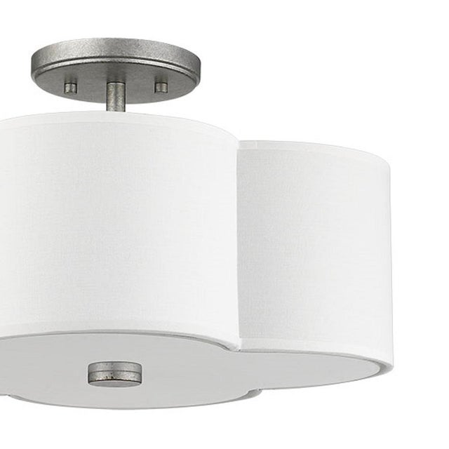 An elegant quatrefoil flush mount adds charm and elegance to any room. Takes 60W bulb.