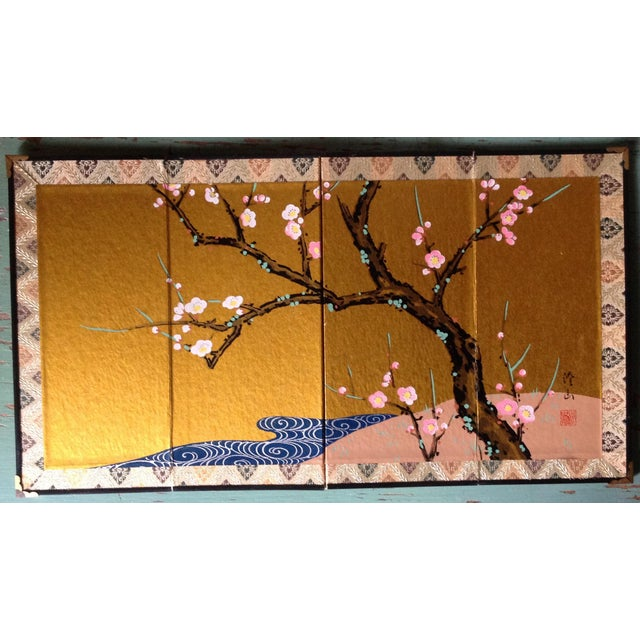Small Asian screen depicting cherry blossoms on a branch. Silk frame with metal hardware. Sweet for a bedside table or...