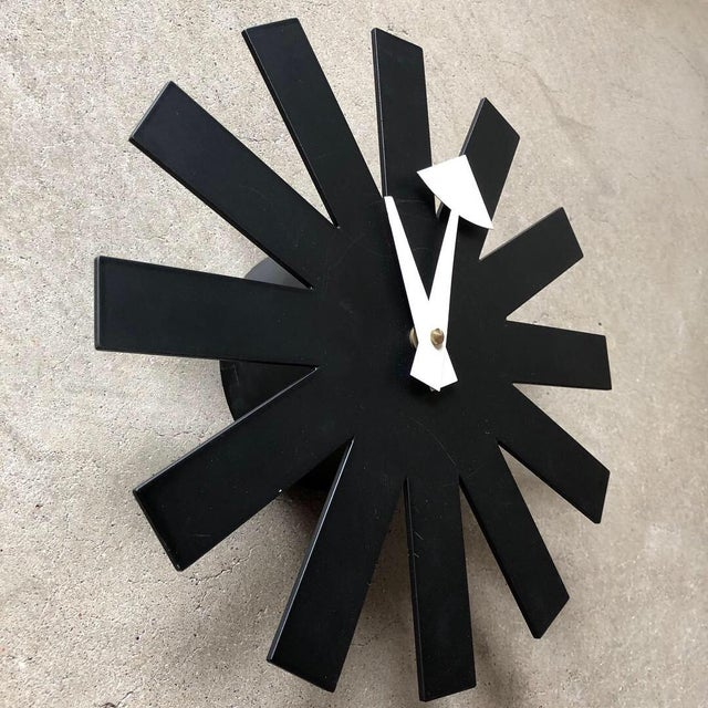 Black metal asterisk wall clock by George Nelson. Official licensed Vitra production, originally produced by Howard...
