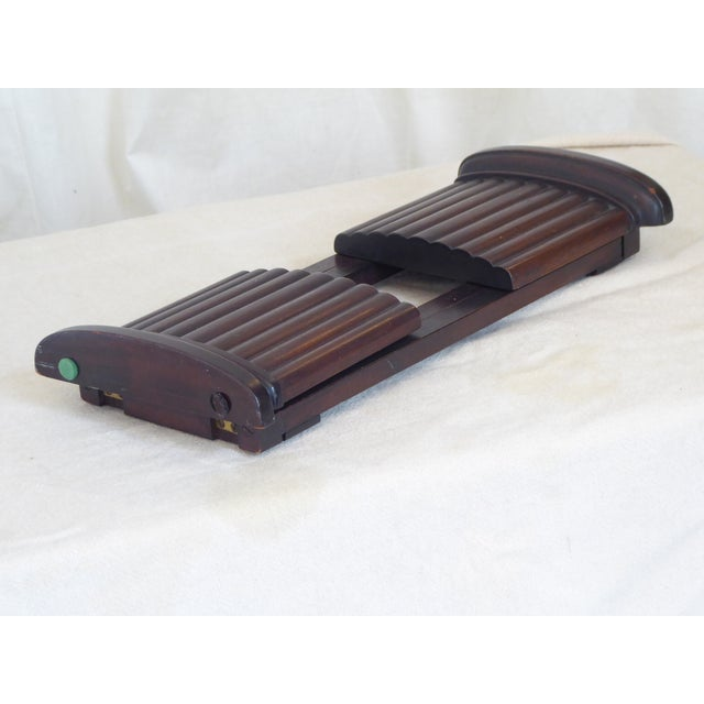 """20th Century mahogany tone wooden book ends, joined by sliding mechanism with a span that goes from 15"""" to 26""""."""