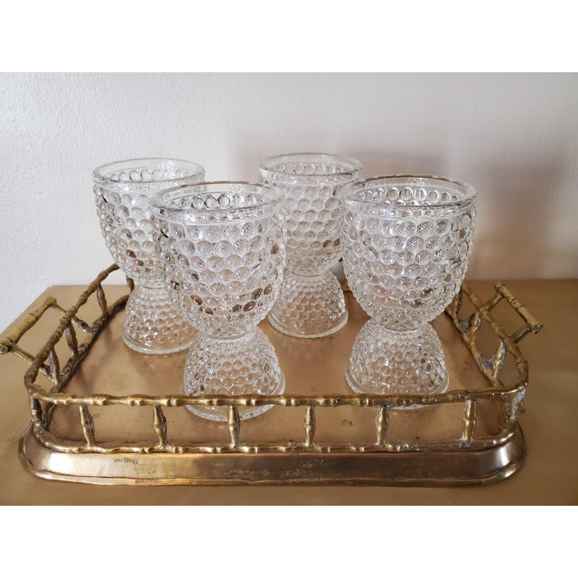 Set of 4 super cute hobnail glass egg cups. These can be used as unexpected shot glasses, as miniature vases, to hold eggs...