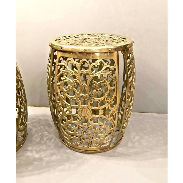 Great pair of cast brass stools with the casting in the form of scrolling vines and central floral motif. The stools are...