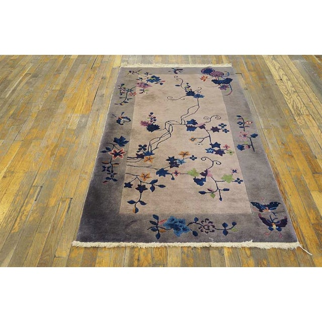 Antique Art Deco Chinese Rug with a gray background and patterned border.