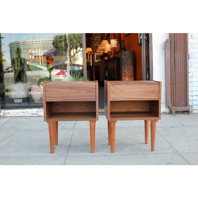 Absolutely stunning pair of mid-century style American walnut hand made night stands. The nigh stands are design and made...