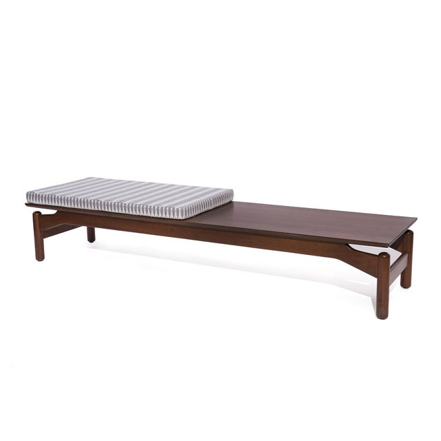 Greta Grossman for Glenn of California walnut and upholstered bench or coffee table, circa early 1960's. This example has...