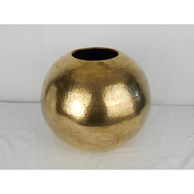 Circa 1970s, large round hammered brass vase. This stunning form is polished without lacquer and can be utilized as...