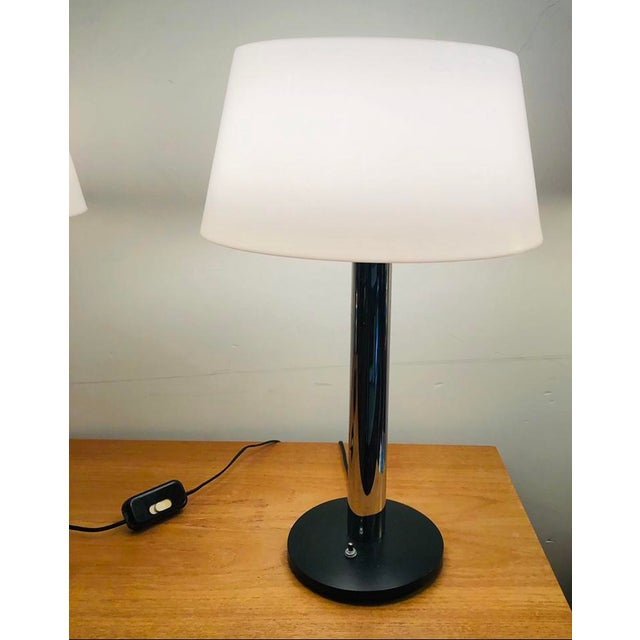 Clean modern lines and minimal detail are the hallmarks of this Mid-Century table lamp designed by Gerald Thurston for...