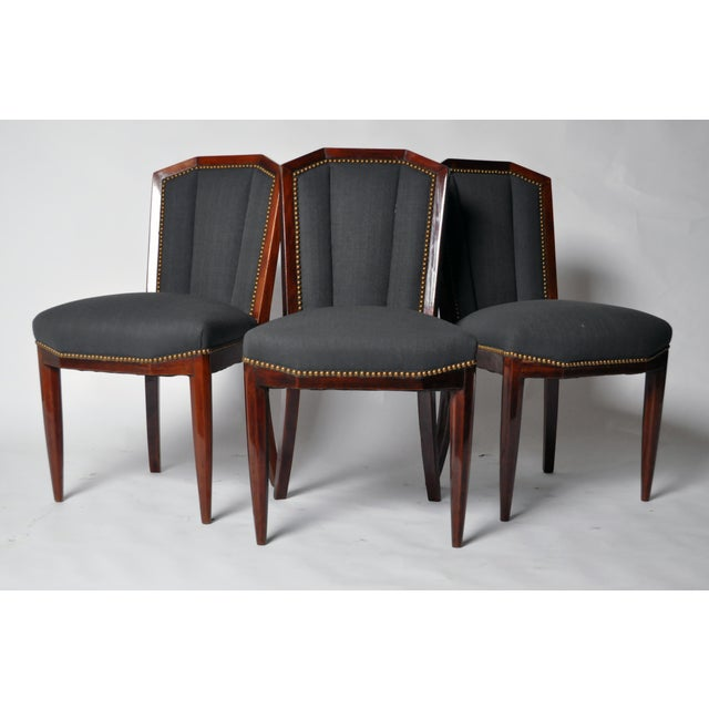 This beautiful set of six Art Deco dining chairs is from France and is made from Palisander, circa 1940. The chairs have...