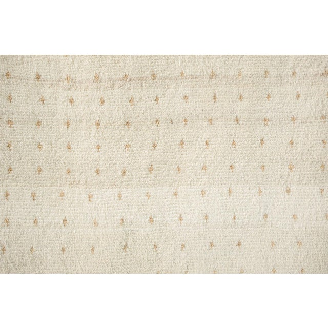name: Majid origin: Iran (Persian) style: Gabbeh, rug, carpet material: hand knotted wool colors: cream, tan, brown age:...