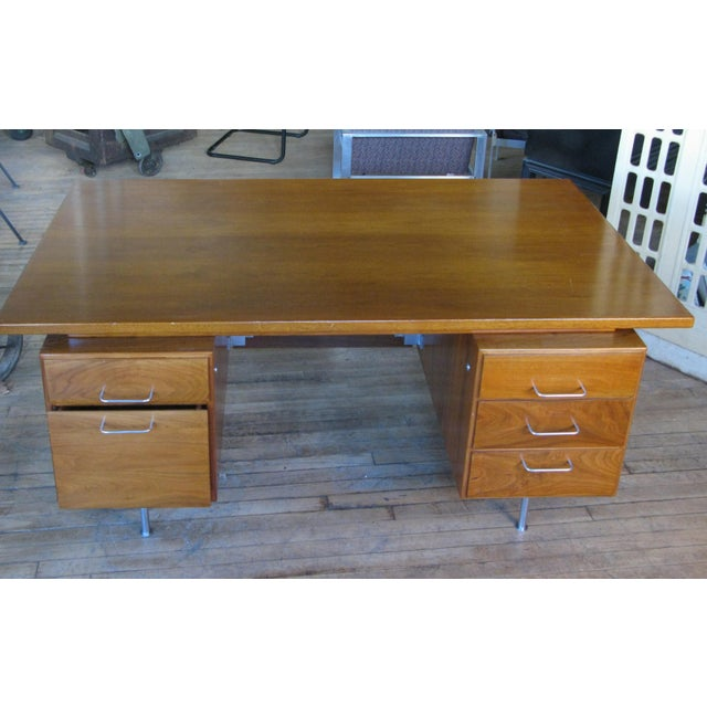 A very handsome vintage 1950s walnut executive desk designed by Jens Risom. Beautiful design with the case raised on steel...