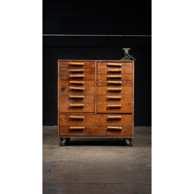 This vintage wooden cabinet was reclaimed from an old industrial environment and features unique handmade drawer pulls....